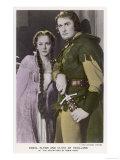 "Erroll Flynn as Robin and Olivia de Havilland as Maid Marian in """"The Adventures of Robin Hood"""" 1938"