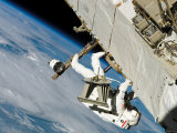 An Astronaut Mission Specialist, Crawls Along a Truss on the International Space Station