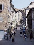 View up Via Raffaello, Urbino, Marche, Italy