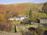 Old Stone Packhorse Bridge Over Watendlath Beck with Dry Stone Wall and Farm Buildings