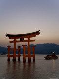 Vermillion Coloured 'Floating' Torii Gate Illuminated at Dusk, a Shinto Shrine Gate, Miyajima