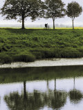 Cyclist on Banks of River Somme, St. Valery Sur Somme, Picardy, France