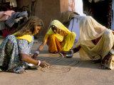 Women Painting a Mandana on the Ground, Village Near Jodhpur, Rajasthan State, India