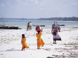 Young Girls and Their Mother Walking Along the Beach, Zanzibar, Tanzania, East Africa, Africa