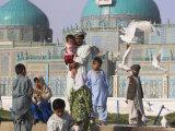 Family Feeding the Famous White Pigeons, Shrine of Hazrat Ali, Mazar-I-Sharif, Afghanistan