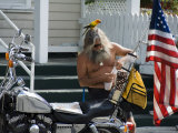 Motorcyclist with Bird on Head, Duval Street, Key West, Florida, USA