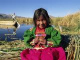 Portrait of a Uros Indian Girl Holding Pan Pipes, Islas Flotantes, Lake Titicaca, Peru