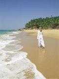 Woman Tourist Walking Along the Beach, Kovalam, Kerala State, India, Asia