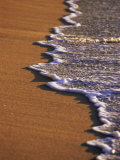 Close-up of Surf on a Sandy Beach