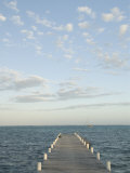 Ambergris Caye Pier in the Afternoon, Clouds and Boat near San Pedro, Belize