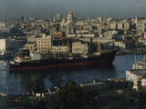 City and a Massive Freighter as It Cruises the Canal, Havana, Cuba