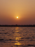 Indian Sunrise over the Holy Ganges River the Ganga at Varanassi