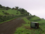 Discarded Television Sits by the Side of a Dirt Road
