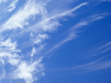 Whispy Stark White Cirrus Clouds in a Vast Blue Sky, Australia