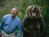 A Man and a Trained Grizzly Bear Snarl for the Camera