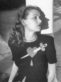 Model Wearing Sweater with Heart Pierced by Jeweled Dagger