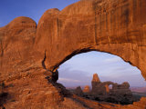 Double Arch Frames Turret Arch at Dawn, Arches National Park, Utah, USA
