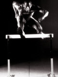 Portrait of a Young Man Jumping over a Hurdle