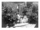 Two Women in their Garden in Cuba Photograph - Cuba