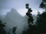 Peak of Gunung Budda Through Early Morning Fog