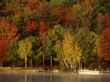 Lake and Boat with Fall Forest in Early Morning, New Hampshire, USA