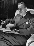 German-Born Writer Thomas Mann Reading a Book at Home