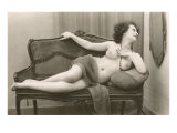 Semi-nude Woman on Cane Divan Looking in Mirror