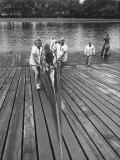 Sen. Leverett Saltonstall, Helping His Crew Members Carry the Canoe on Deck at Harvard