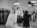 Shoppers Searching for Evening Gowns in the Women's Wear Dept. of Saks Fifth Ave. Department Store