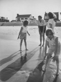 Wife of Project Mercury Astronaut, Mrs. Alan B. Shepard, Jr., Playing with Family on the Beach
