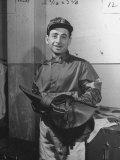 Jockey Johnny Longden Smiling and Holding Saddle