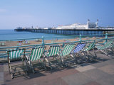 Deckchairs Above the Beach and the Palace Pier at Brighton, Sussex, England, United Kingdom, Europe