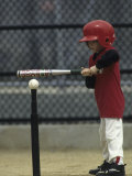 Young Boy Batting During a Tee Ball Game