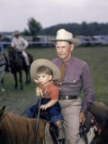 Grandfather and His Grandson Ride a Horse at a Rodeo