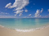 Perfect Beach Day with Blue Skies, Clear Water, Puffy White Clouds