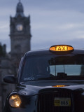 Taxi with Balmoral Hotel in Background