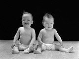 Twin Babies Sitting Wearing Diapers, Laughing and Smiling