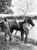 Couple Walking Horses Side By Side, Lake in Background