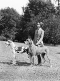 Young Woman, Two Great Dane Dogs on a Leash