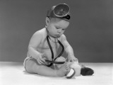 Baby Dressed in Diaper Stethoscope and Opthalmoscope
