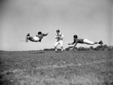 Three Teenage Boys Playing American Football, Two About To Tackle Boy Holding Ball