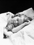 Girl Sleeping, Head on Pillow, Baby Doll Toy Under Arm