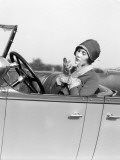 Woman in a Cloche and Gloves Holding Compact