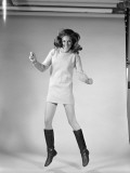 Woman Dancer in Mini-Dress and Black Go-Go Boots Jumping in Air