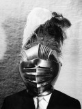 Man in Suit Wearing Armour Helmet With Plumes, Portrait