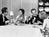 Two Couples Wearing Formal Dress, Sitting at Table Eating and Talking
