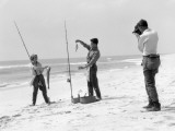 Woman and Two Men All Are Wearing Surf Fishing Gear