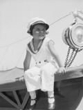 Girl in Sailor Suit Sitting on Edge of Sailboat, Outdoors