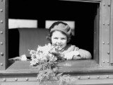 Girl on Train, Holding Bouquet of Flowers, Wearing Hat and Jacket