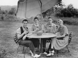 Two Couples Having Beer at Garden Table, Portrait